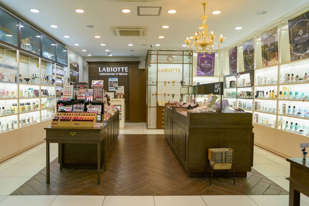 The inside of a Labiotte store with two islands of products in the middle of the store