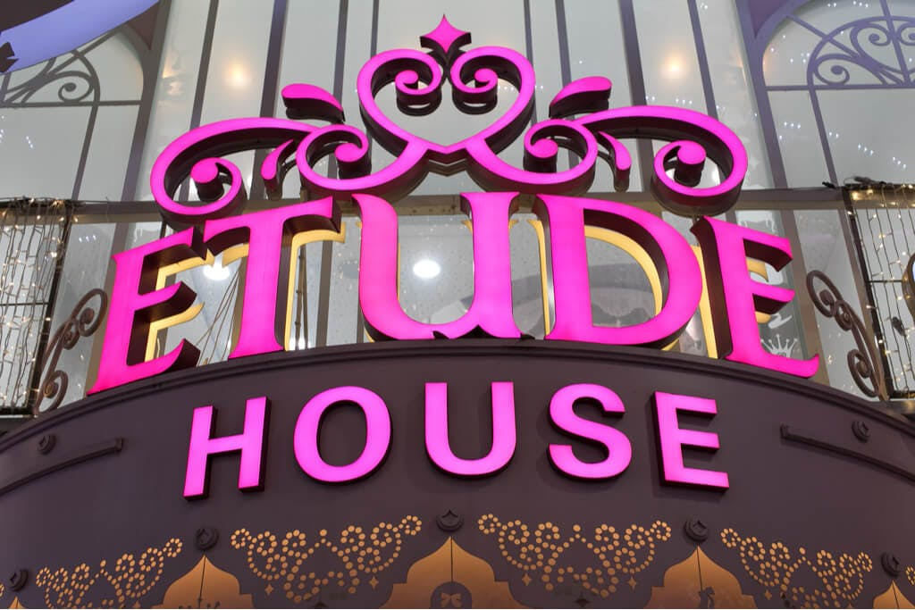A pink Etude House sign above a store entrance.
