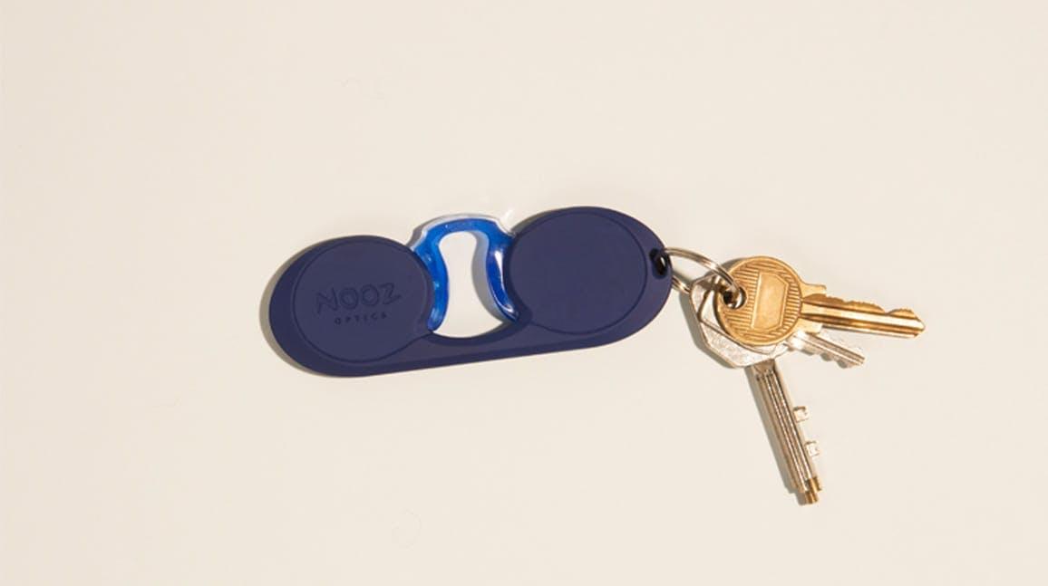 Nooz Optics original blue oval armless reading glasses with keys