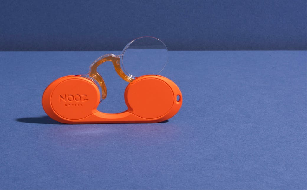 Nooz Optics original orange oval armless reading glasses