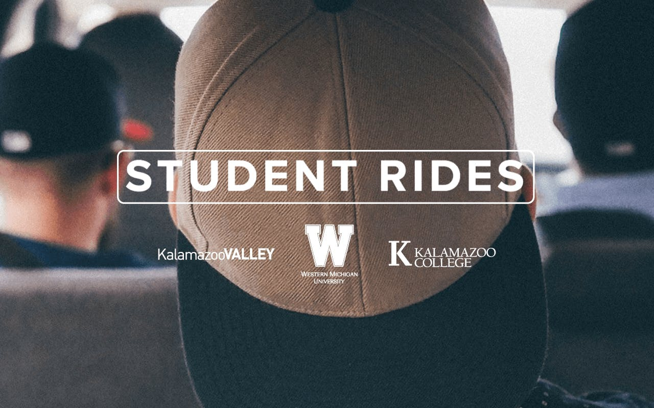 College students riding in a car together.