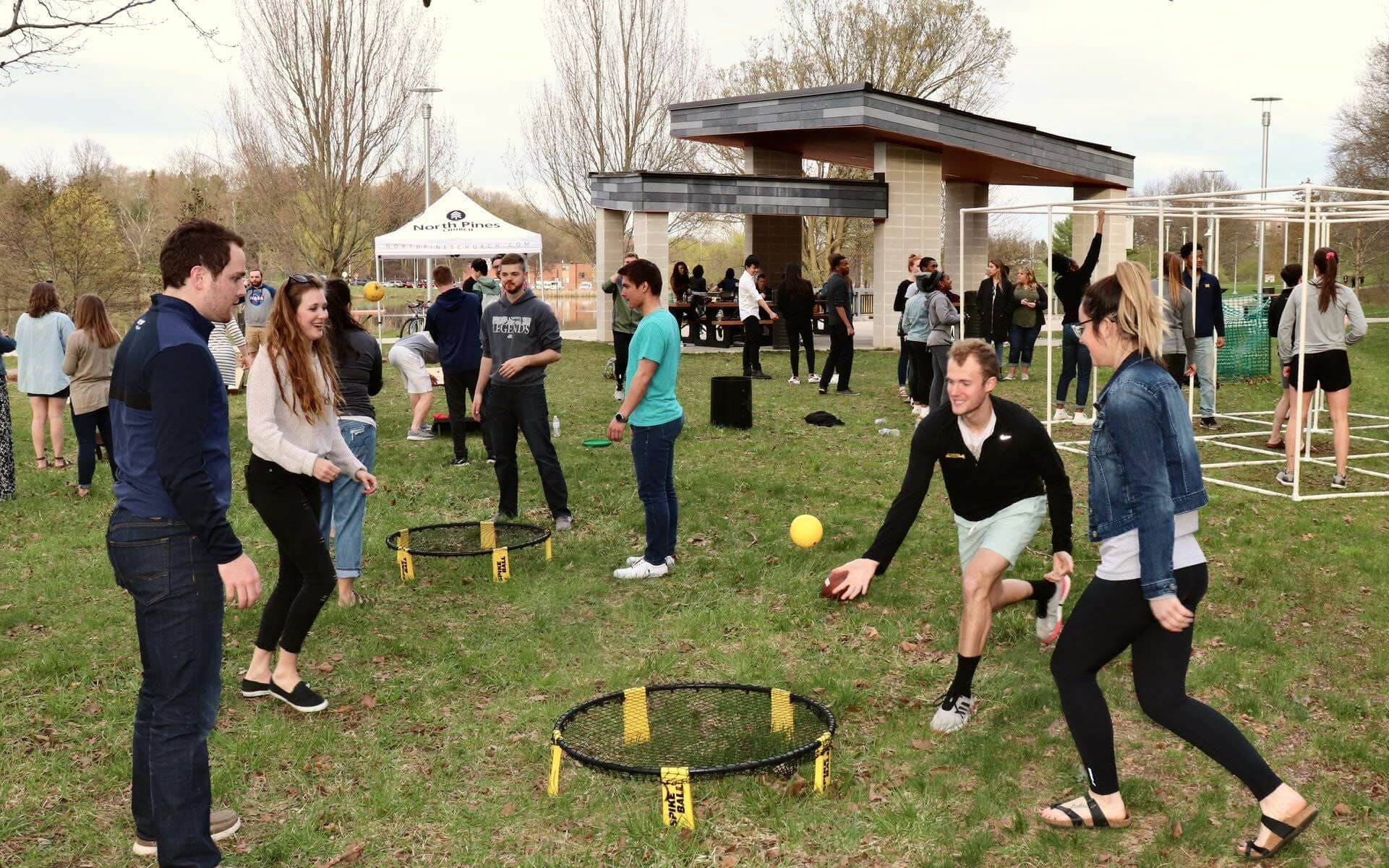 A group of college students playing spike ball on Western Michigan's campus.