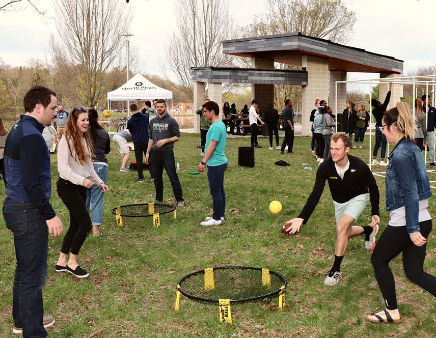 North Pines college students playing spike ball on Western Michigan campus.
