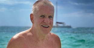 Pat Corbin smiles while enjoying a day on the water.