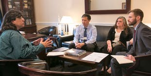 Advocates sit and discuss how to improve health options for psoriasis and psoriatic disease patients.