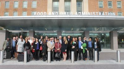 People with psoriatic disease gather outside the FDA after a PFDD meeting.