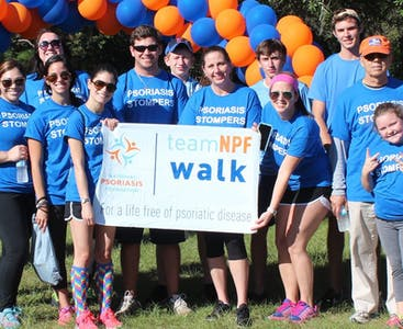 A group poses during a Team NPF Walk charity event.