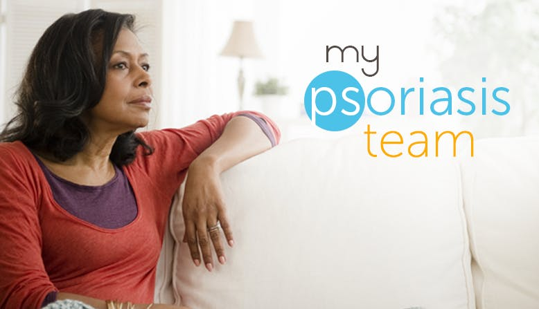 A woman sits on the couch. my psoriasis team