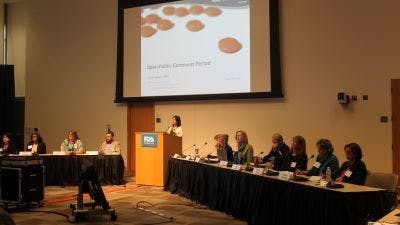 A panel of FDA reps from the department of dermatology and dentistry listen to people with psoriasis and PsA.