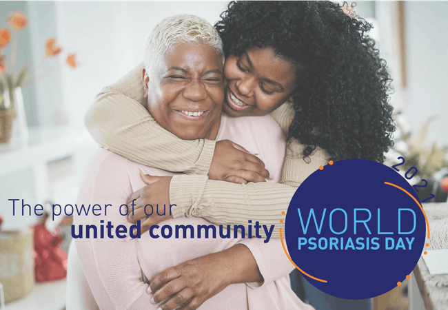 """A mother and daughter hugging each other with the text """"The power of our united community - World Psoriasis Day 2021""""."""