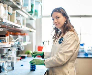 Researcher Charlotte Hurabielle-Claverie, M.D, works in a lab where she researches psoriatic disease.