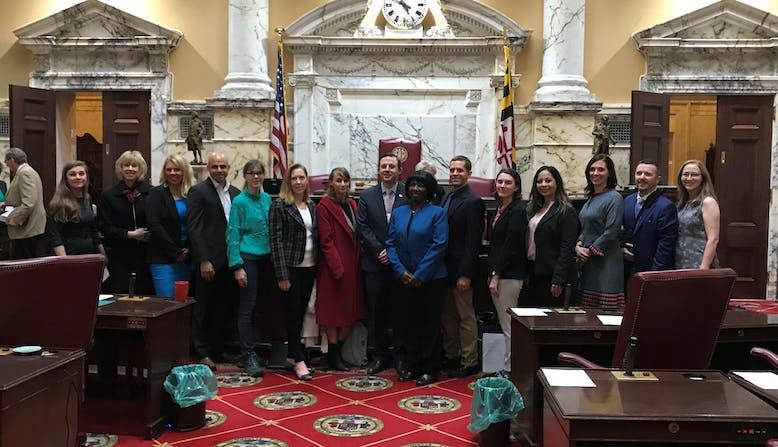 Advocates standing together in a legislative building.