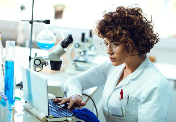 Woman working on computer in a lab