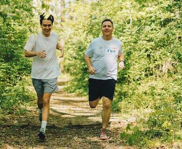 Derek and Issac Schujahn run together outside for Team NPF.