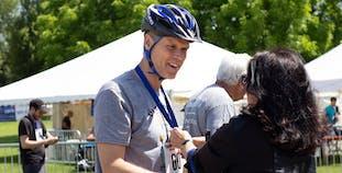 Matt Mercier receives a medal after participating in a Team NPF Cycle event.