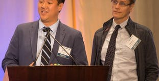 Wilson Liao, M.D. (left), and Johann Gudjonsson, M.D., Ph.D., present at NPF Cure Symposium.
