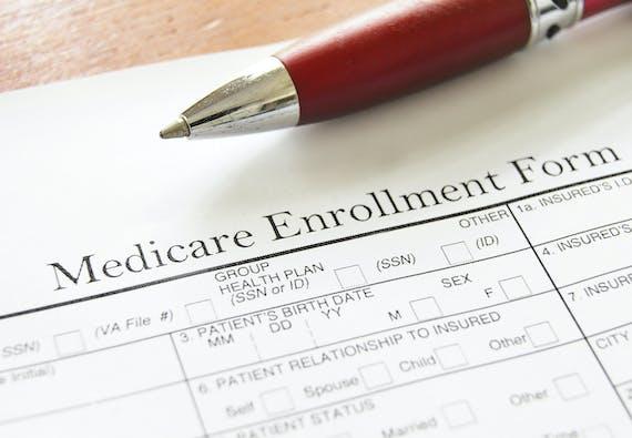 Close up photo of a Medicare Enrollment Form.