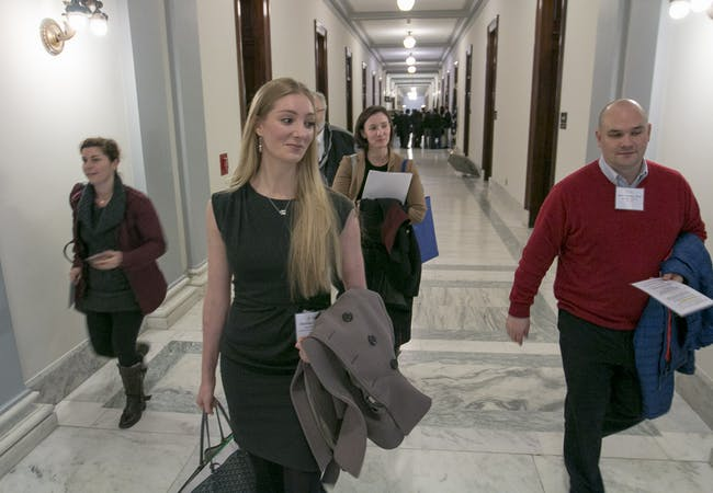 NPF advocates walking in a legislative building.