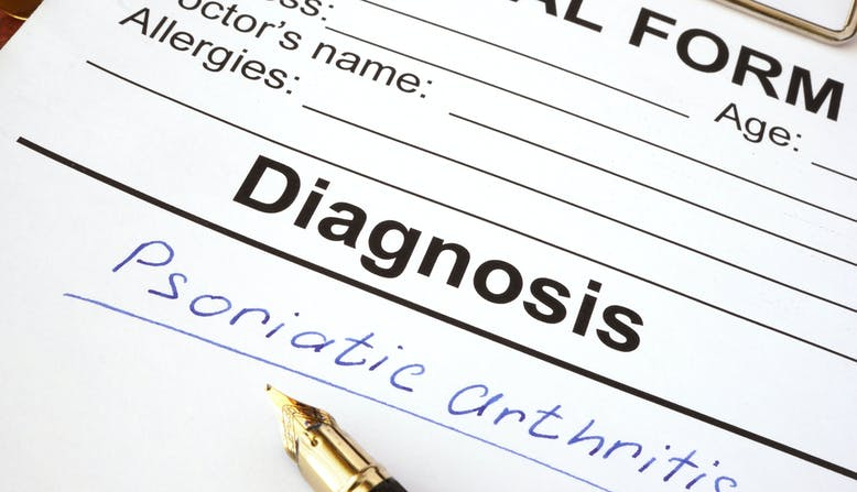 A medical diagnosis chart with psoriatic arthritis written on it.