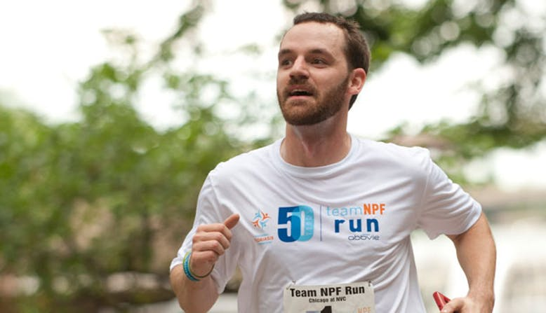 Runner Craig with a Team NPF Run shirt at the NYC Marathon.
