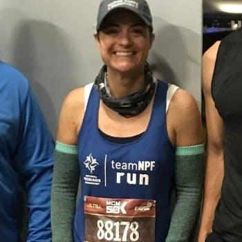 Female runner, Jennifer Kerner, poses with Team NPF after the Marine Corp 50K