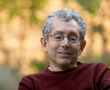 Fred Finkelstein, a filmmaker with longstanding psoriasis and psoriatic arthritis, smiling.