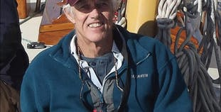 Dudley Dix smiles while on his boat. Read how he saw the silver lining to his psoriasis diagnosis.