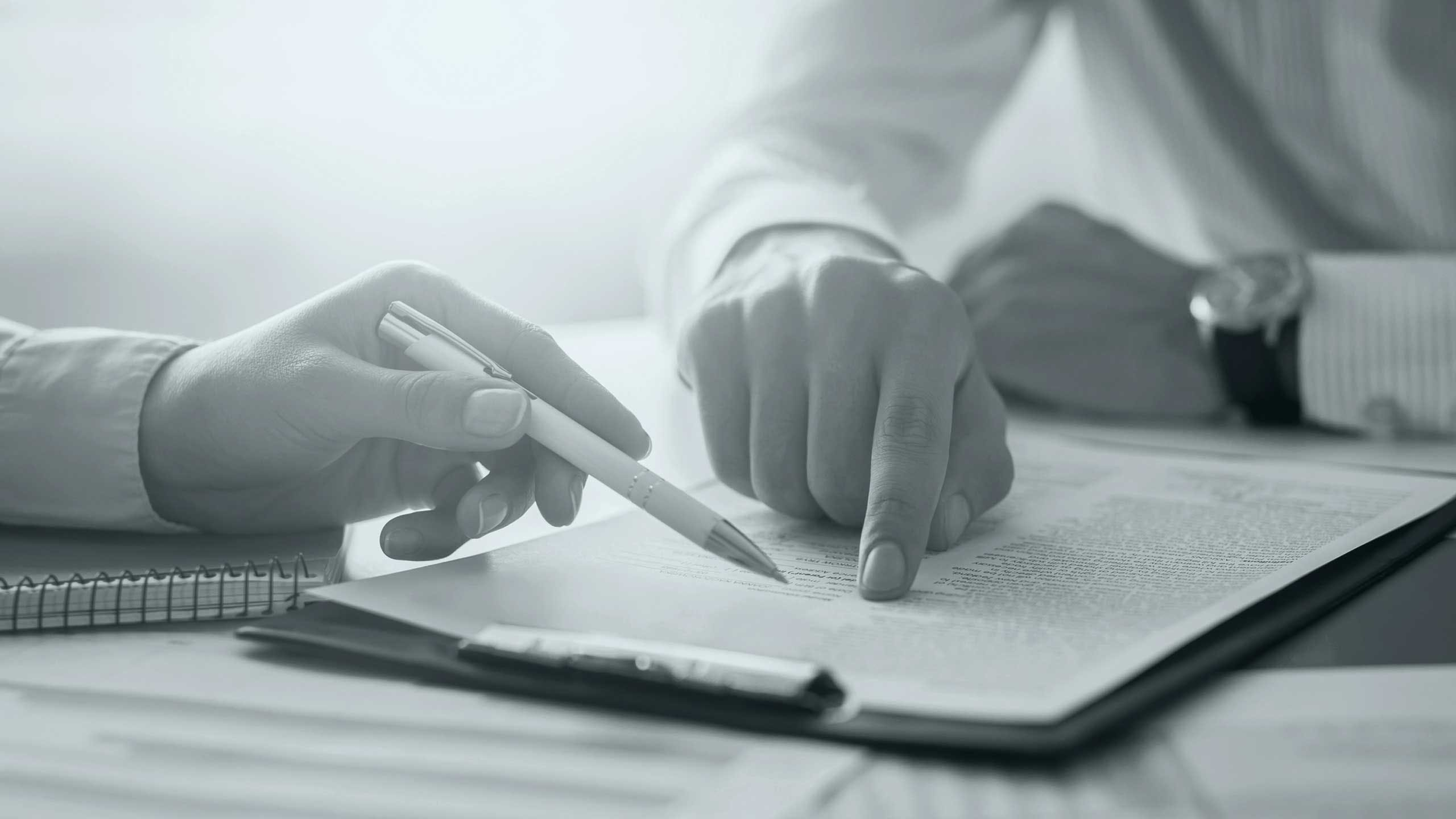Cropped image of people signing a contract