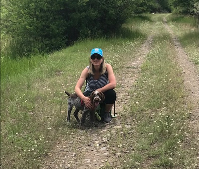 Esther du Crocq on the trail with her loyal dog companion