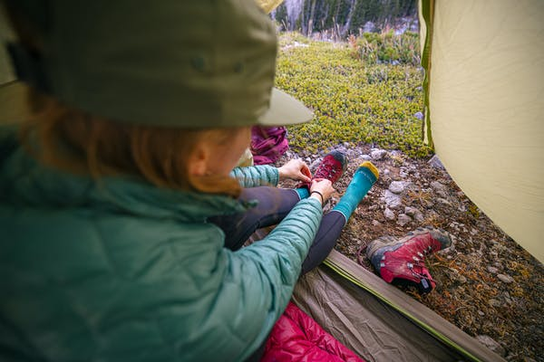 Keeping her feet warm and dry in the Bridger Mid Waterproof while camping