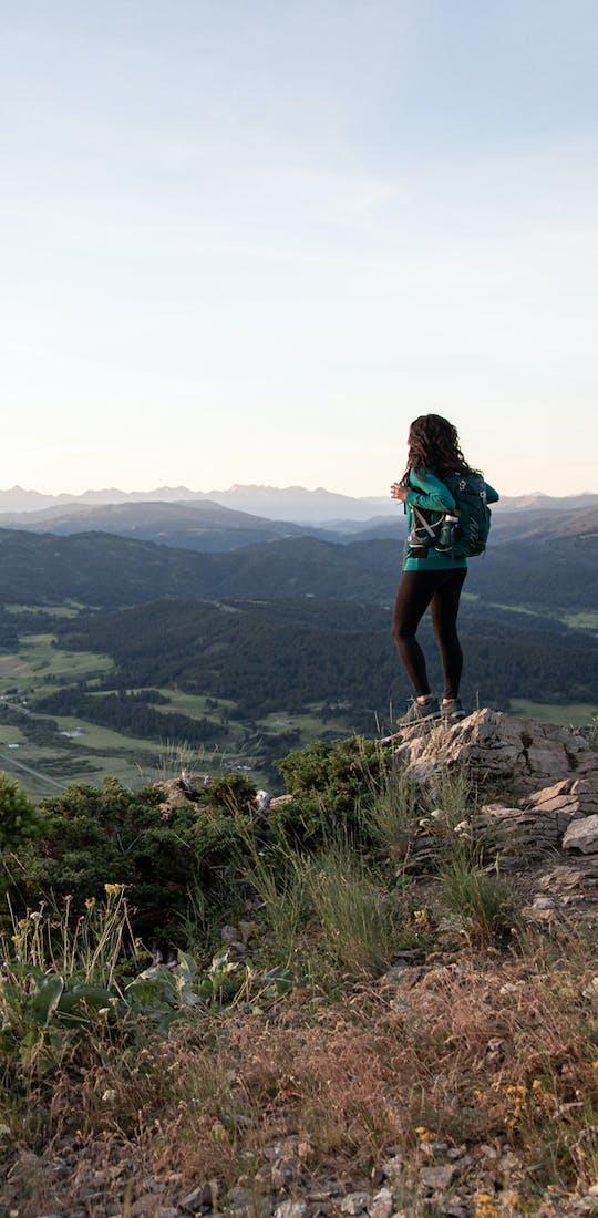 Jackie Nourse overlooking mountain ranges