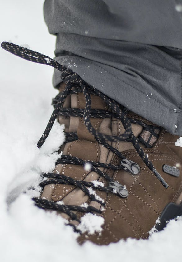 Oboz insulated boots hiking through the snowy conditions
