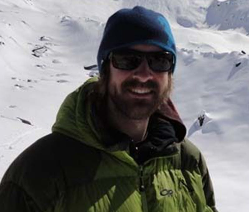 Steve Lowry exploring in the snowy mountains