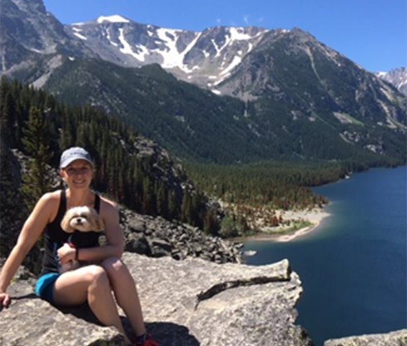 Erin Johnson with her dog on a hike