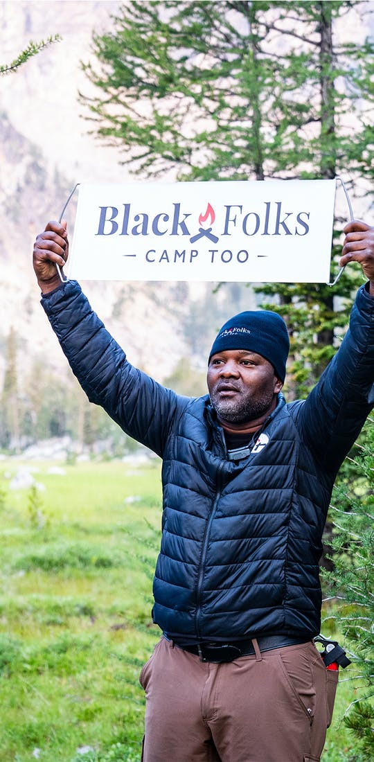 BFCT founder holding up the BFCT sign.