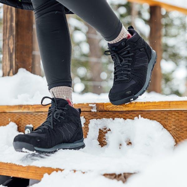 The Bozeman walking down snowy steps