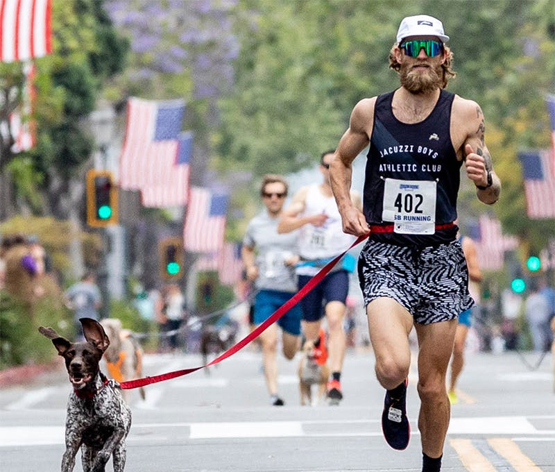 Dan Wehunt running with his dog in a race