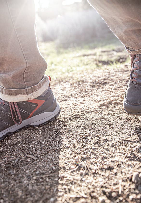 A hiker walking in the Oboz Men's Sypes Low Leather Waterproof on the trail