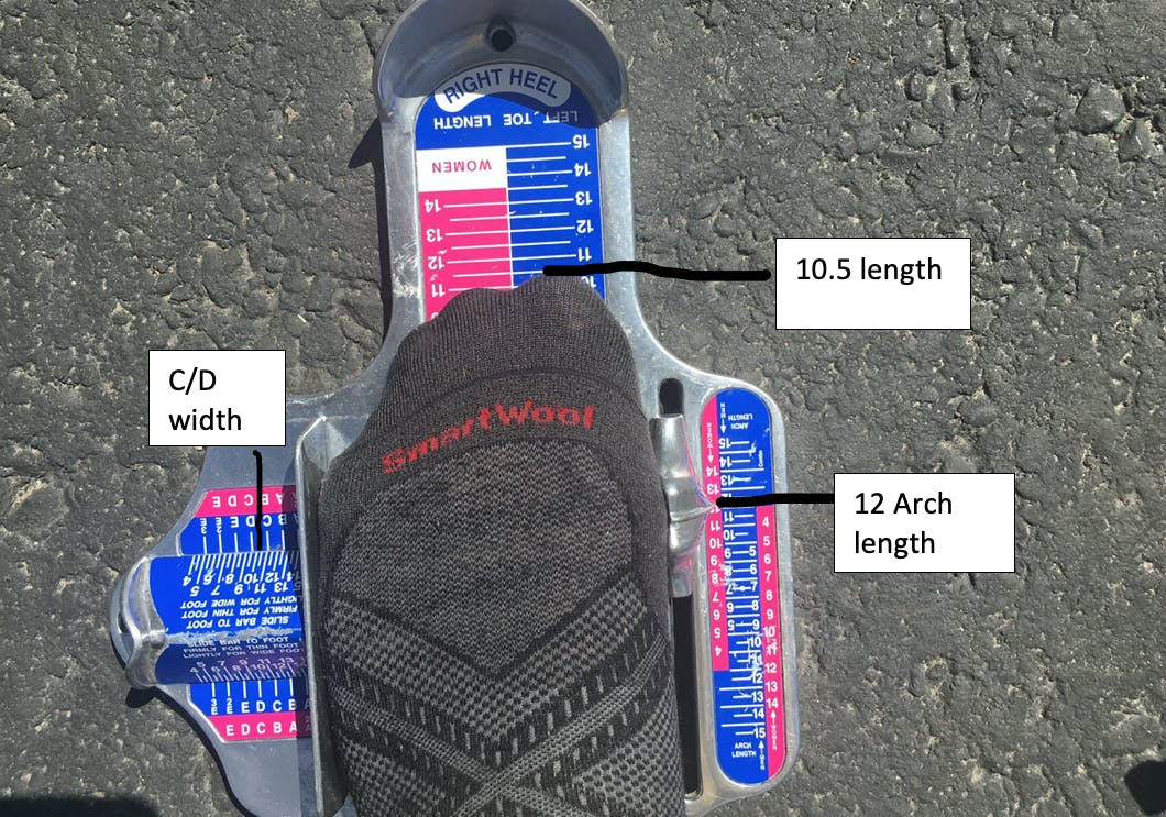 Here, the Brannock device measures this man's foot length at 10.5, arch length at 12, and a foot width at C/D.