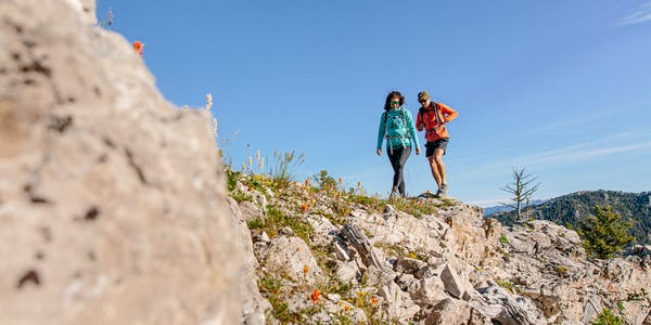 Two hikers exploring on the trail wearing Oboz