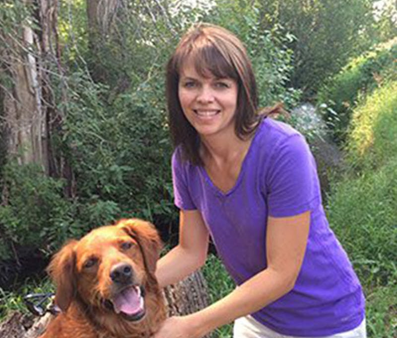 Pam Malyurek taking a picture with her dog