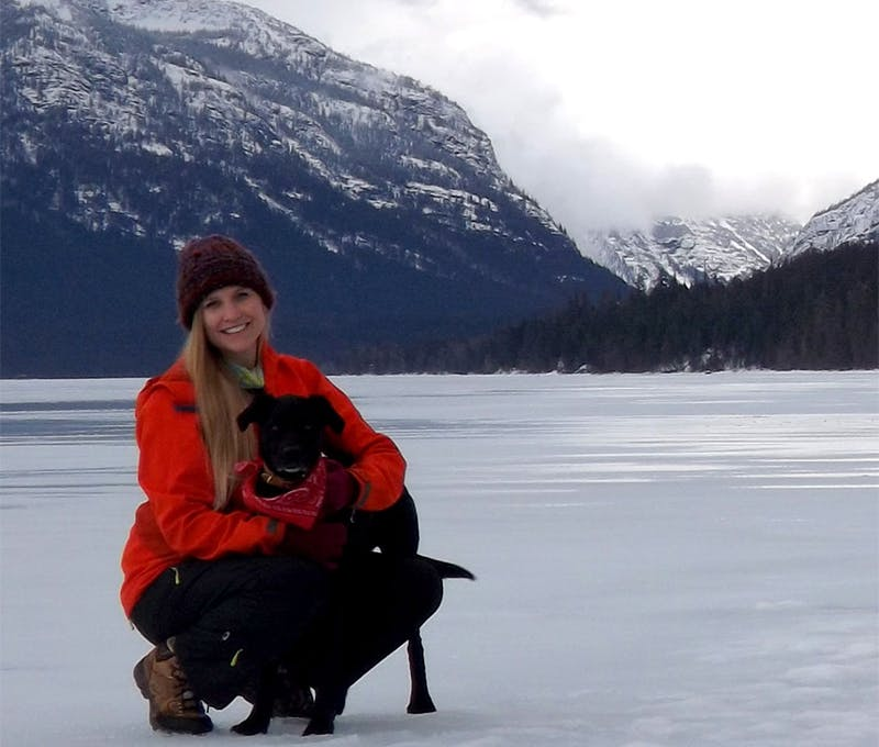 Kelly Schell with her dog on a hike