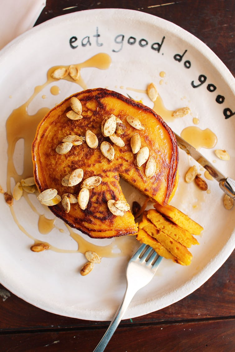 Stack of butternut and turmeric pancakes served on a plate
