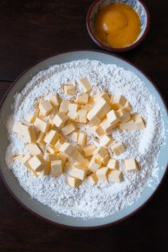 Butter chunks, flour and sugar in a bowl