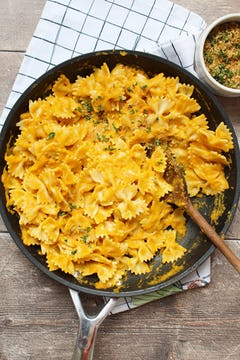 carrot sauce mixed with the pasta in a pan