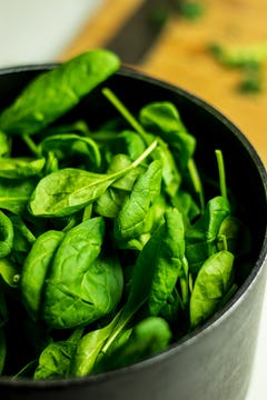 Fresh spinach in a pot.