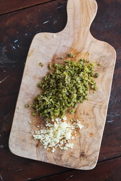 finely chopped garlic and rocket on a chopping board