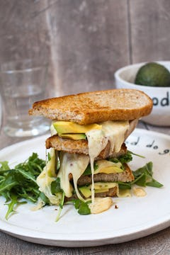 Plate with grilled cheese and avocado sandwich