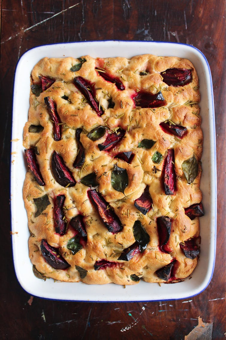 Beetroot focaccia bread on a baking tray