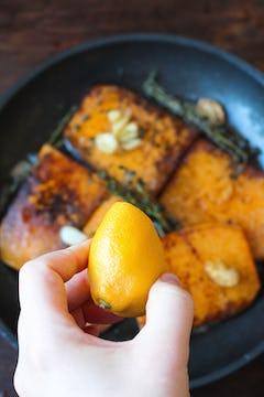 Lemon juice is added to frying pan